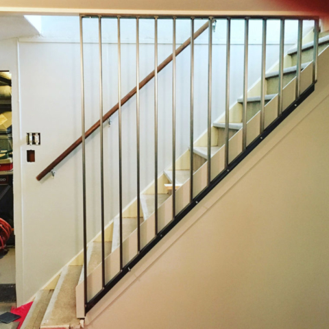 Custom Metal Railing and Wall in Basement