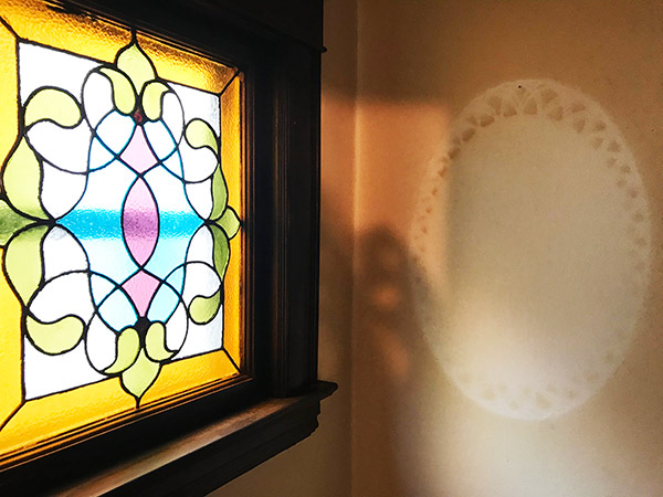 minneapolis-mn-stained glass-window-and-doily
